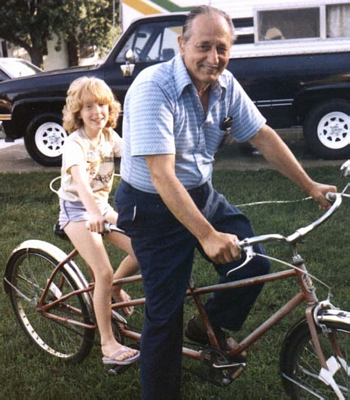 Rose Painter with Harold Kissell on a bicycle built for two.